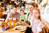 Bavarian family having traditional meal in German restaurant
