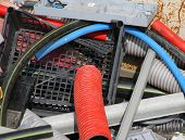 foto of landfills  - pieces of broken plastic and cable conduit pipes in a container of a hazardous waste landfill - JPG