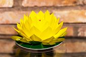 pic of memory stick  - Flower Lotus origami recycled paper craft stick on brick wall background