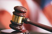 stock photo of proceed  - Gavel and american flag - JPG