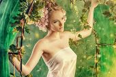 image of loach  - Beautiful young woman standing under an arch of flowers and overgrown loach - JPG