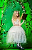 image of loach  - Lovely girl in a lush white dress sitting at the table under a floral arch over green background - JPG