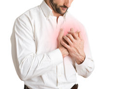 stock photo of breast-stroke  - Man having a pain in the heart area isolated in white red circle around painful area - JPG