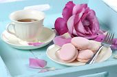 picture of blue rose  - Stylish elegant shabby chic style vintage aqua blue tray with macarons cup of tea and bright pink rose - JPG