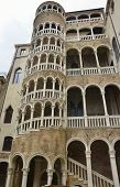 picture of spiral staircase  - The Palace Contarini del Bovolo is a small palace in Venice Italy best known for the external spiral staircase with a plethora of arches - JPG