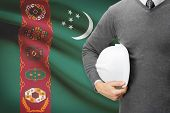 picture of turkmenistan  - Architect with flag on background  - JPG