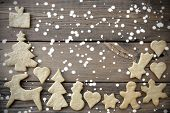 picture of ginger bread  - Ginger Bread Cookies building a Frame on Wooden Background in the Snow with Copy Space - JPG