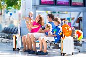 picture of big-girls  - Big happy family with three kids traveling by airplane at  airport parents with teenager boy toddler girl and little baby holding colorful luggage for summer beach vacation  - JPG