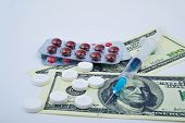 foto of two dollar bill  - Pills in packings - JPG