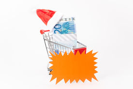 stock photo of caddy  - Caddy for shopping with money stack on white background - JPG