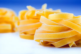 picture of pene  - Tagliatelle pasta on white blue background - JPG