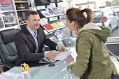 pic of rental agreement  - Car dealer editing purchase agreement to buyer - JPG