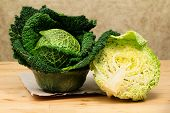 stock photo of neutral  - savoy cabbage just picked up against neutral nackground - JPG