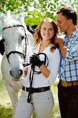 image of white horse  - Image of happy woman between purebred horse and her sweetheart outside - JPG