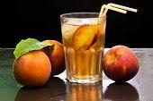 image of peach  - peach iced tea over wet slate background - JPG