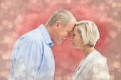 stock photo of male pattern baldness  - Happy mature couple facing each other against light glowing dots design pattern - JPG