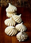 pic of vanilla  - Arrangement of Vanilla Meringues Cakes In a Row on Wooden Background - JPG