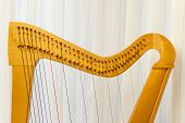 stock photo of celtic  - Top part of a celtic harp instrument - JPG