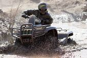 stock photo of overcoming obstacles  - Extreme driving ATV on overcoming mud obstacles - JPG
