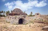 picture of karnataka  - Ancient ruins of Vijayanagara Empire at blue sky in Hampi Karnataka India - JPG
