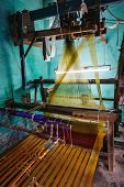 pic of sari  - Man weaving silk sari on loom - JPG