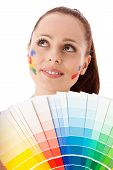 stock photo of interior decorator  - The beautiful young woman with a color guide on a white background - JPG