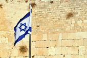 image of wall-stone  - The Israeli National Flag against the Kotel Wailing Western Wall empty at night in Jerusalem Israel - JPG