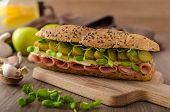 stock photo of baguette  - Baguette with the Prague ham pickles microgreens healthy herbs and emmental cheese - JPG