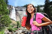 picture of bottle water  - Healthy hiker girl drinking water in nature hike - JPG