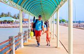 foto of passenger ship  - happy father and son are going to board a ship at the pier station - JPG