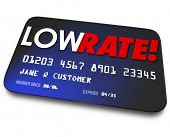 pic of plastic money  - Low Rate words on a credit card to illustrate percentage interest charged on your payments or money owed to finance company - JPG