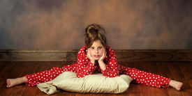 picture of poka dot  - A pretty preteen with her pillow doing splits in poka - JPG