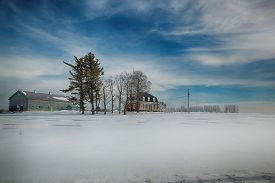 picture of farmhouse  - Farmhouse and building during winter season in Beauce area near Quebec - JPG