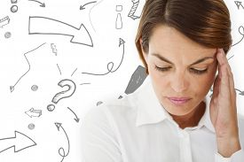 image of punctuation marks  - Woman with headache against arrows pointing to exclamation mark - JPG