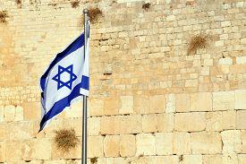 image of israel people  - The Israeli National Flag against the Kotel Wailing Western Wall empty at night in Jerusalem Israel - JPG