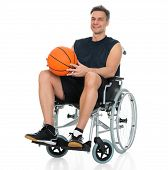 pic of disability  - Disabled Player On Wheelchair Holding Basketball Over White Background - JPG