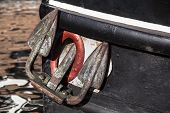 foto of anchor  - Antique anchor of a black river boat - JPG