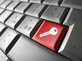 foto of key  - Access key Internet security concept with key icon and symbol on a red laptop computer key for website blog and on line business.