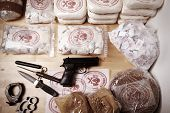 pic of drug dealer  - Drug packages raw opium drug dozens and weapons seized by police - JPG