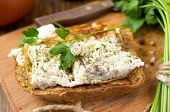 foto of scrambled eggs  - Toast with scrambled eggs on a wooden board with parsley - JPG