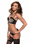 stock photo of panty-hose  - Beautiful young brunette in black and gold lingerie - JPG
