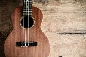 picture of ukulele  - Close up of ukulele on old wooden background Dark tone - JPG