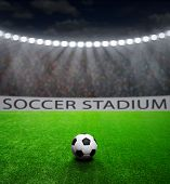 foto of arena  - Soccer ball on green stadium - JPG