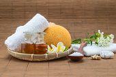 stock photo of bath sponge  - spa bath salt spoon towel sponge essential oil and flower for spa health - JPG
