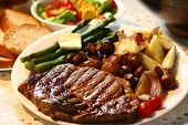 stock photo of ribeye steak  - home cooked meal ribeye potatoesfresh asparagusbread and salad - JPG