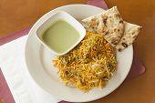 picture of biryani  - Indian biryani chicken with naan and mint coriander chutney sauce - JPG