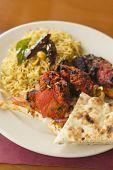 pic of tamarind  - Indian tandoori chicken with fresh naan and tamarind rice  - JPG