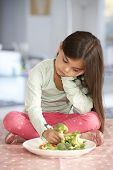 foto of fussy  - Unhappy Young Girl Rejecting Plate Of Fresh Vegetables - JPG