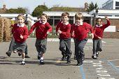 pic of playground school  - Elementary School Pupils Running In Playground - JPG