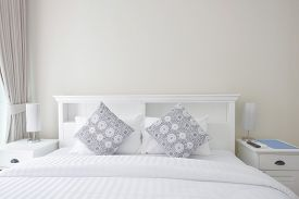 image of flat-bed  - White pillows on a bed Comfortable soft pillows on the white bed - JPG